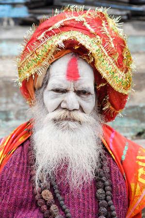 jainism: Varanasi, India - 27 January 2015: Holy Man posing at Varanasi, the holiest of the seven sacred cities (Sapta Puri) in Hinduism, and Jainism