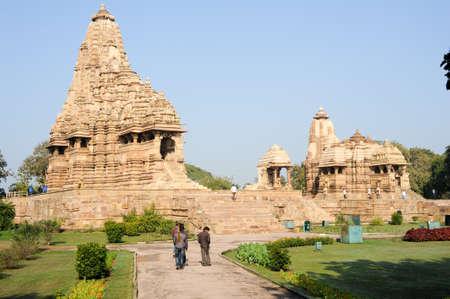 khajuraho: Khajuraho, India - 30 January 2015: People climb to the hindu temple on UNESCO World Heritage Site, Khajuraho Group of Monuments built between 950 and 1150