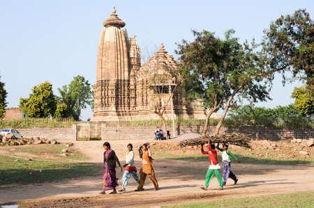 khajuraho: Khajuraho, India - 30 January 2015: People walking in front of Khajuraho temple on India