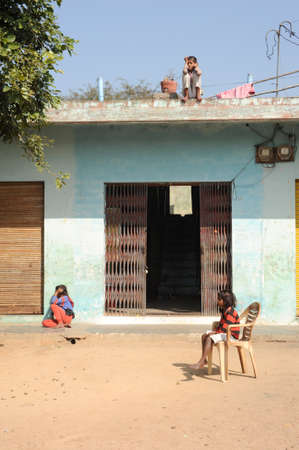 khajuraho: Khajuraho, India - 31 January 2015:childs in front of them house at the village of Khajuraho on India Editorial