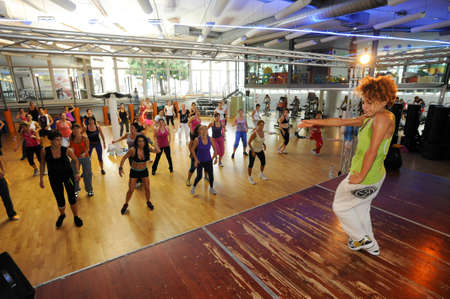 zumba: Lugano, Switzerland - 6  October 2013: People dancing during Zumba training fitness at a gym of Lugano on Switzerland