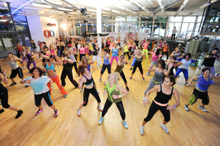 Lugano, Switzerland - 10 november 2013: People dancing during Zumba training fitness at a gym of Lugano on Switzerland Editorial