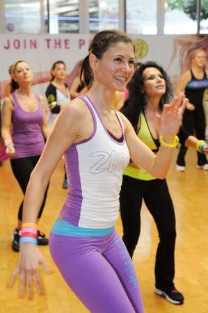 aerobics class: Lugano, Switzerland - 10 november 2013: People dancing during Zumba training fitness at a gym of Lugano on Switzerland Editorial