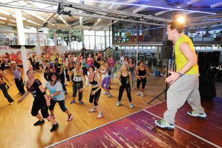 beat women: Lugano, Switzerland - 10 november 2013: People dancing during Zumba training fitness at a gym of Lugano on Switzerland Editorial