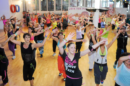 Lugano, Switzerland - 10 november 2013: People dancing during Zumba training fitness at a gym of Lugano on Switzerland Editorial