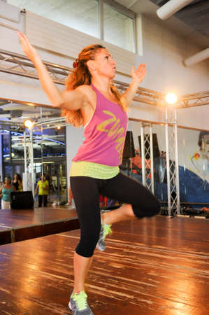 beat women: Lugano, Switzerland - 6  October 2013: People dancing during Zumba training fitness at a gym of Lugano on Switzerland