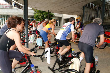 pedaling: Lugano, Switzerland -17 June 2005: People pedaling during a spinning class