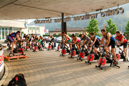 pedaling: Lugano, Switzerland -24 June 2005: People pedaling during a spinning class Editorial