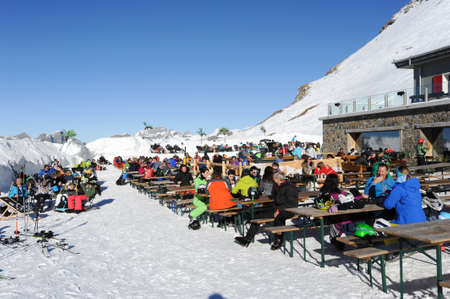 Engelberg, Switzerland - 18 February 2015: Sci tourists drinking and eating at the restaurant on mount Titlis over Engelberg on the Swiss alps