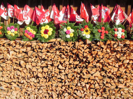 Wood, flowers and Swiss flags at Engelberg on the alps photo