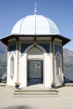 summerhouse: Bellagio, Italy - 13 April 2015: People resting and eating at the summerhouse of Villa Melzi at Bellagio on lake of Como, Italy