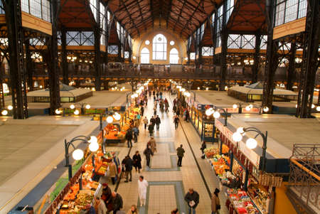 Budapest, Hungary - 14 January  2005: People shopping in the Great Market Hall who is the largest indoor market in Budapest, built in 1896