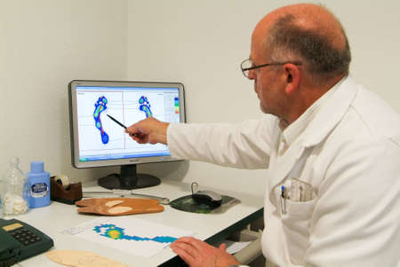 Locarno, Switzerland: 4 May 2010: Doctor preparing orthopedic insoles for a patient on his studio