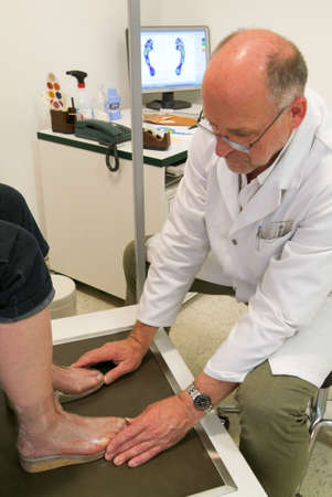 flatfoot: Locarno, Switzerland: 4 May 2010: Doctor preparing orthopedic insoles for a patient on his studio