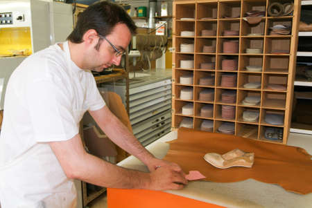flatfoot: Locarno, Switzerland: 4 May 2010: Worker preparing orthopedic insoles for a patient on his workshop