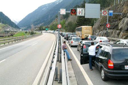 Göschenen, Switzerland - 27 April 2008: vehicles waiting in line for entering Gotthard tunnel on the Swiss alps