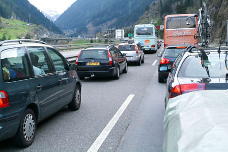 Göschenen, Switzerland - 27 April 2008: vehicles waiting in line for entering Gotthard tunnel on the Swiss alps Editorial
