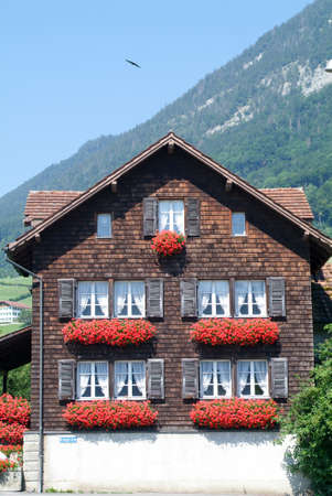 Traditional Swiss Country House On The Alps Photo