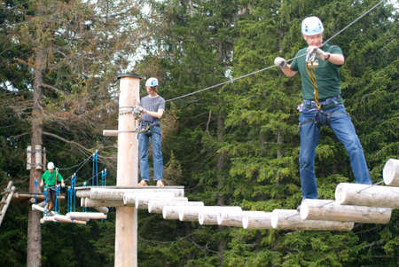 lipno: Mount Pilatus, Switzerland - 23 August 2006: Visitors in adventure park clambering with ropes wear protective helmets