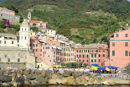 vernazza: Vernazza, Italy - 8 July 2015: People swimming and sunbathing at the town of Vernazza on Cinque Terre, Italy
