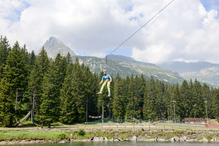 bernardino: San Bernardino, Switzerland - 21 July 2015: Girl in the adventure rope park of San Bernardino on Mesolcina valley, Switzerland Editorial