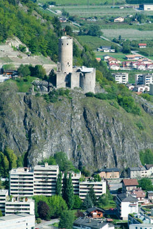 cylindrical: Ancient castle with cylindrical tower of Martigny on the Swiss alps