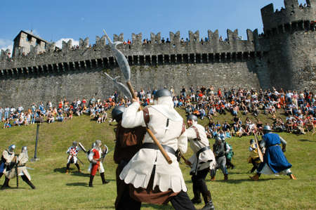 reenacting: Bellinzona,Switzerland - 29 May 2004: Knights in action during the annual medieval Festival la spada nella roccia at the castle of Montebello in Bellinzona, Switzerland