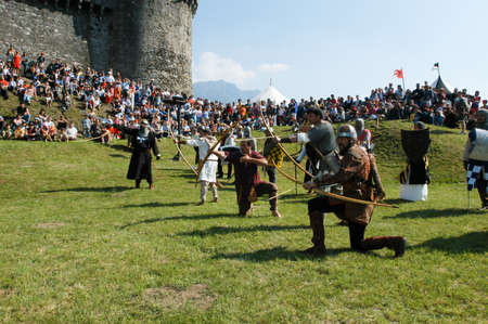 historical events: Bellinzona,Switzerland - 29 May 2004: Knights in action during the annual medieval Festival la spada nella roccia at the castle of Montebello in Bellinzona, Switzerland