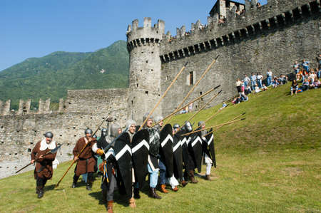reenact: Bellinzona,Switzerland - 29 May 2004: Knights in action during the annual medieval Festival la spada nella roccia at the castle of Montebello in Bellinzona, Switzerland