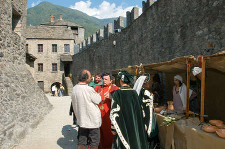 reenacting: Bellinzona,Switzerland - 29 May 2004: People at the market during the annual medieval Festival la spada nella roccia at the castle of Montebello in Bellinzona, Switzerland