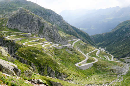 Old road with tight serpentines on the southern side of the St. Gotthard pass bridging swiss alps