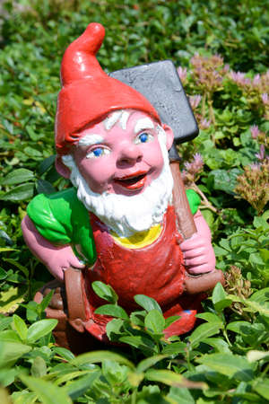 lawn gnome: Garden gnome in a garden of a house at Engelberg on the Swiss alps