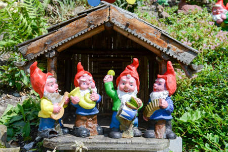 lawn gnome: Garden gnomes in a garden of a house at Engelberg on the Swiss alps
