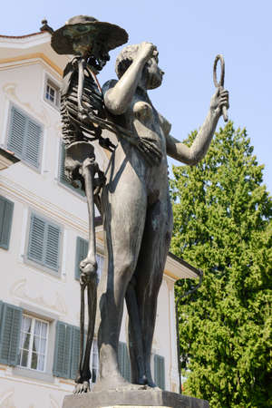 renaissance art: Stans, Switzerland -12 August 2015: Bronze sculpture Death and the Maiden by Rolf Brem. Death and the Maiden is a common motif in Renaissance art, which was developed from Dance of Death.