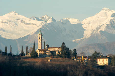 collina: The church of Sant Abbondio at Gentilino in front of the Swiss alps