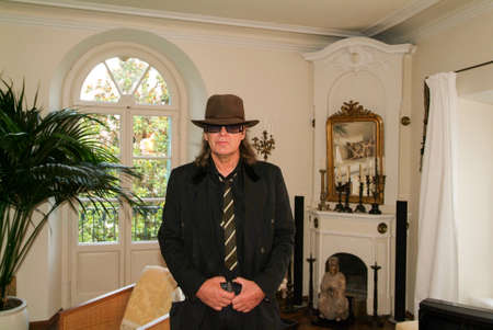 hesse: Montagnola, Switzerland - 5 August 2007:  the German singer Udo Lindenberg posing in the apartment where lived the famous writer Hermann Hesse