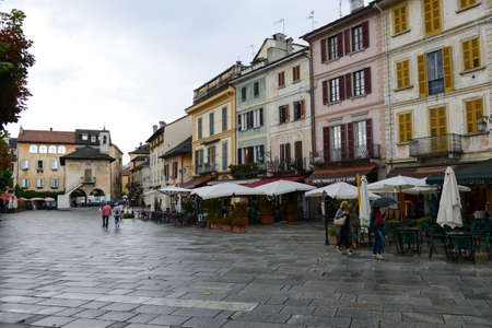 orta: Orta, Italy - 5 September 2015: People visiting on walking the village of Orta on Piedmont, Italy