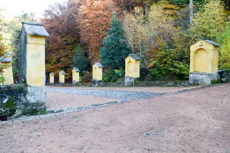 crucis: Autumnal landscape of the via crucis at Carona on the italian part of Switzerland Stock Photo