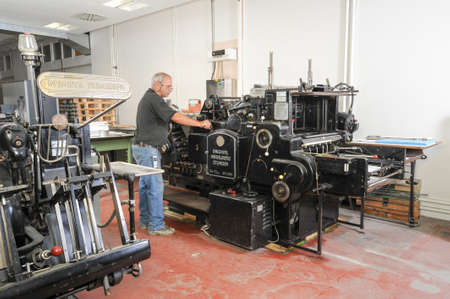 lithograph: Bern, Switzerland - 19 september 2013: people working at an offset printing machine at Bern on Switzerland