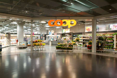 public market sign: Lugano, Switzerland - 1 July 2010: interior of Coop supermarket store on the mall of Lugano on Switzerland Editorial