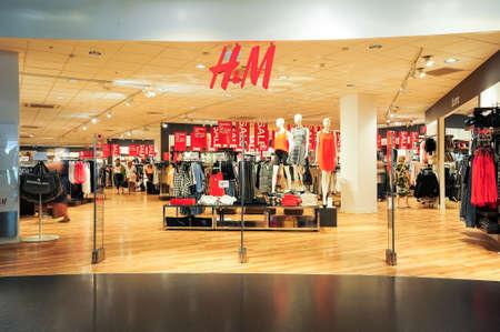 hm: Lugano, Switzerland - 17 July 2014: interior of H&M fashion clothes store on the mall of Lugano on Switzerland Editorial