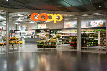 public market sign: Lugano, Switzerland - 1 July 2010: interior of Coop supermarket store on the mall of Lugano on Switzerland Editorial