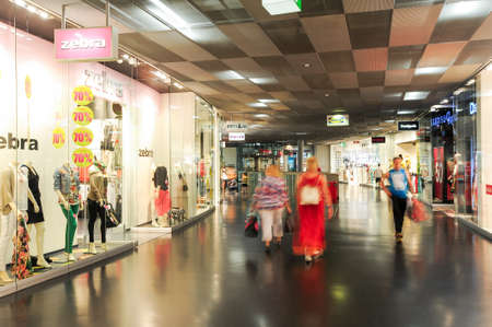 merchandise mart: Lugano, Switzerland - 17 july 2014: people shopping on walking on the stores of the mall at Lugano on Switzerland Editorial