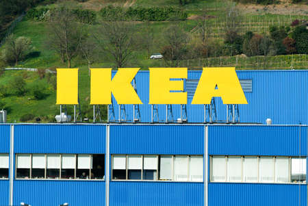 retailer: Lugano, Switzerland - 7 april 2009: IKEA billboard in front of their own appliances retailer. Editorial