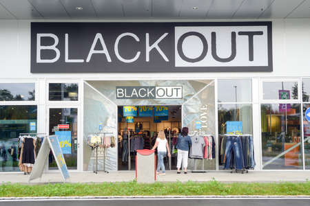 black out: Rothenburg, Switzerland - 24 july 2014: people shopping at the store of Black Out on the mall at Rothenburg on Switzerland