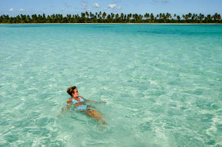 Saona Island, 1 february 2002 - woman swimming at the beach of Saona Island, Dominican Republic Editorial