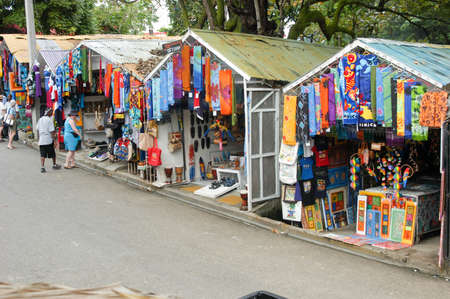 the merchant of venice: Sosua, Dominican Republic - 16 january 2002: People shopping on the stalls with colorful souvenirs at Sosua, Dominican Republic