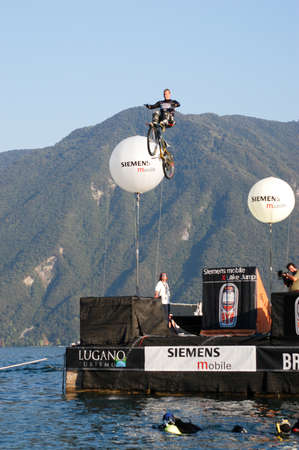 gazer: Lugano, Switzerland - 4 september 2002: people during an acrobatic jumps competition with bikes at Lugano on the italian part of Switzerland Editorial