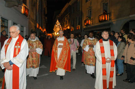 procession: Mendrisio, Switzerland - 18 april 2003: people carrying lanterns during the annual procession to Jesus Christ at Easter in Mendrisio on Switzerland