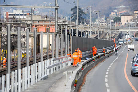 Capolago, Switzerland - 29 february 2012: Workers during the installation of noise barriers on the railway at Capolago on Switzerland Editorial